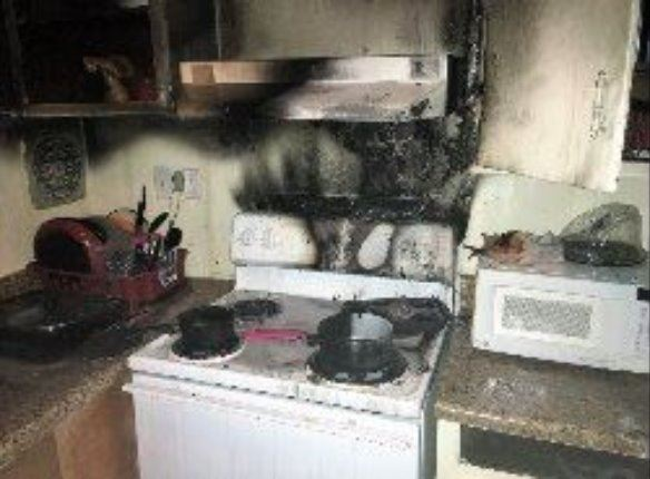 Image of a kitchen stove that has burned