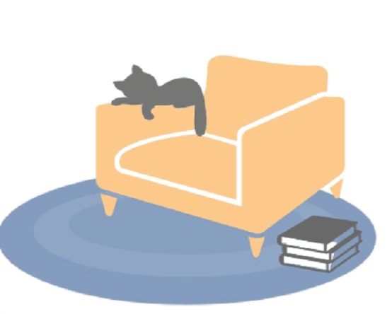 Cat snuggled on chair next to stack of books