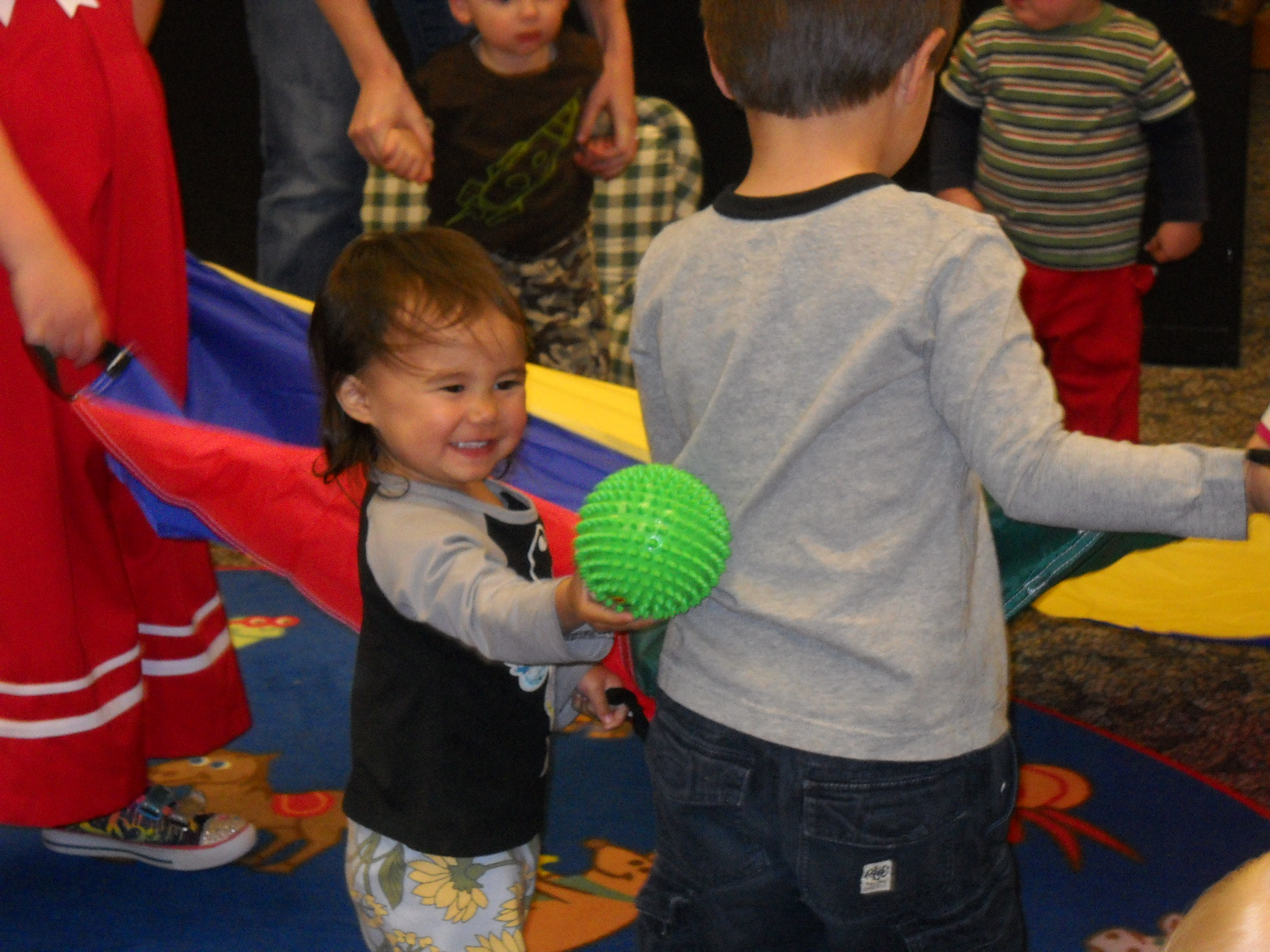 Toddler playing with ball at storytime