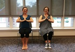 Kelly and Laurel practice Chair Yoga at the Library